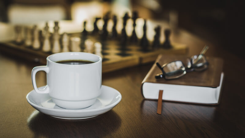 still life photography coffee and chess