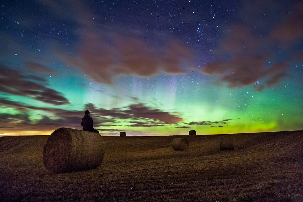 Tyler Gerritsen - northern lights with hay bales